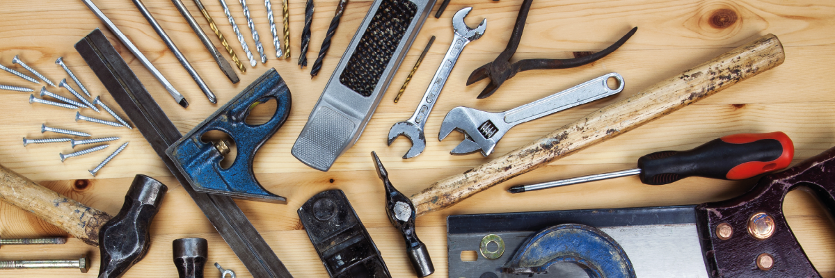 Selection of woodworking tools on a bench to depict Useful Tools for Web Designers and Digital Marketers - Pharian