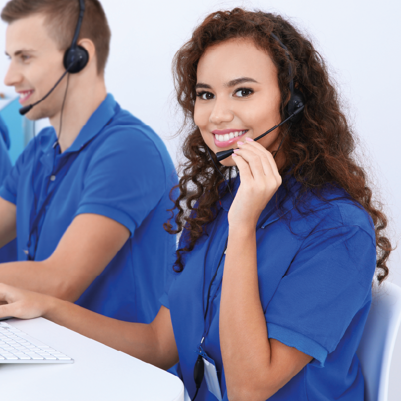 Picture of female IT Helpdesk worker wearing headset and smiling