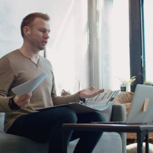 Man working from home at laptop to represent Secure Remote Working - Pharian IT Services
